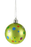 Light-green Christmas ball with colorful spot Stock Photos
