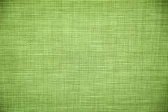 Light green ecologic canvas texture background. Tissue knitted fabric royalty free stock photos