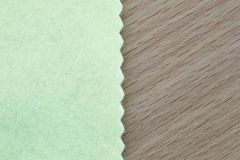 Light Green fabric on brown wooden and have copy space. Royalty Free Stock Photography