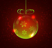 Light green glass ball with snowflakes on a red background Stock Images