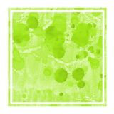 Light green hand drawn watercolor rectangular frame background texture with stains. Modern design element royalty free stock photo