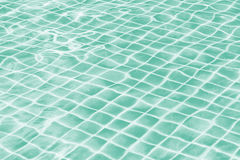 Light green jade swimming pool water texture reflection. Royalty Free Stock Photography