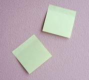 Light green notepad on the wall Stock Image