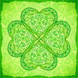 Light green ornate four-leaf clover background Stock Images