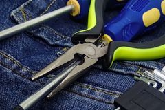 Light green pens pliers screwdriver set repair tools collection furniture construction background background royalty free stock photos