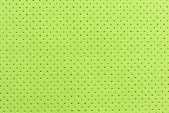 Light Green Perforated Artificial Leather Background Texture Stock Photo