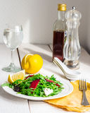 Light green salad with arugula, beets, goat cheese and prunes Royalty Free Stock Photos