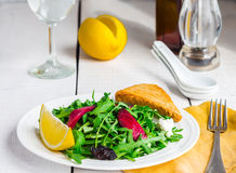 Light green salad with arugula, beets, goat cheese and prunes Stock Photography