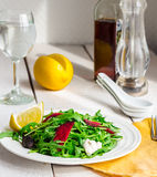 Light green salad with arugula, beets, goat cheese and prunes Stock Photo