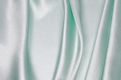 Light green Silk cloth of wavy abstract background Royalty Free Stock Photos