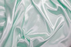 Light green Silk cloth of wavy abstract background Royalty Free Stock Image