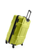 Light green suitcase plastic on two wheels Stock Images