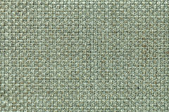Light green textile background with checkered pattern, closeup. Structure of the fabric macro. Royalty Free Stock Images