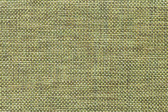 Light green textile background with checkered pattern, closeup. Structure of the fabric macro. Stock Photo
