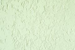Light green textured plastered wall. Fresh otvetka in commercial premises, designer renovation in the house.  royalty free stock image