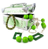 Light green trunk, beads and armlet isolated Stock Image