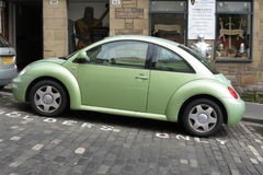 Light green Volkswagen New Beetle car Stock Image