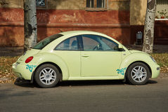 Light green Volkswagen New Beetle car parked in a street Stock Photo