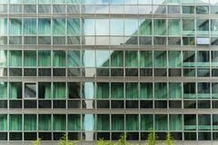 Light green windows on business tower Stock Photography
