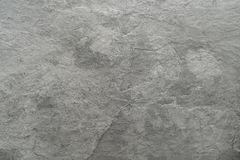 Light grey black slate stone background or texture