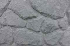 Light grey concrete slab with extruded pattern. Artificial stone Royalty Free Stock Images