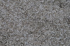 Light grey fine-grained gravel. For surface texturing royalty free stock photography