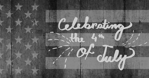 Light grey fourth of July party graphic against grey american flag on wood panel. Digital composite of Light grey fourth of July party graphic against grey Royalty Free Stock Photo