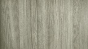 Light grey wood texture with black stripes. Wide and narrow bands royalty free stock photos