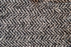 Light grey woolen or tweed fabric for grunge background stock image