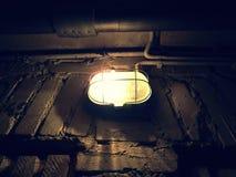 Light on grunge wall Royalty Free Stock Image