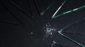 With a light hammer blow, the glass is broken into particles. Slow motion. Glass lies on the table, and with a light blow with a hammer it is told to the fine stock video footage
