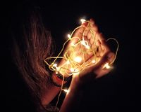 Light in hand toches the Soul. stock photos