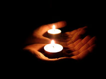Light in hands. Palm with candle in mirror Royalty Free Stock Photos