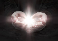 Light in hands - pray the crucifix Royalty Free Stock Images