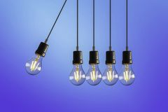 Light hangings over a blue screen stock illustration