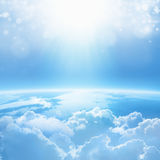 Light from heaven. Blue planet Earth in white clouds, bright sunlight from above. No NASA images used royalty free stock photos