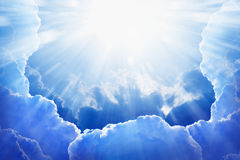 Light from heaven. Peaceful background - beautiful blue sky with bright sun, light from heaven Royalty Free Stock Image