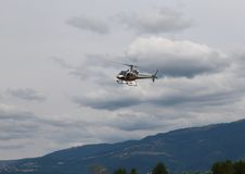 Light helicopter flies in the sky and carries tourists. Civil helicopter flies in the sky and carries tourists for sightseeing Royalty Free Stock Photo