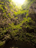 LIGHT HOLE IN THE CAVE. Sunlight through the hole cave Stock Image
