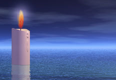 Light of hope. A candle stands as a light of hope in the sea Royalty Free Stock Photo