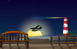 A light house, an airplane and a sea Royalty Free Stock Photos
