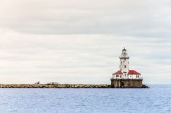 Light house along side  Lake Michigan seen from th Stock Images