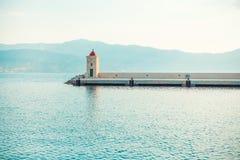 Light-house in the beautiful harbor of a small town Postira - Croatia, island Brac. Light-house in the beautiful harbor of a small town Postira - Croatia, Brac Stock Photos