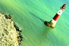 Light house in blue sea Royalty Free Stock Photos