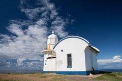 Light house with blue sky. Royalty Free Stock Photo