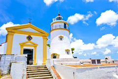 Light house and church in Macau, China. Stock Images