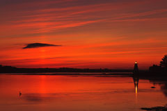 Light House and crane at Sunset Stock Image