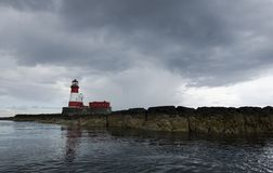 Light house detail. Lighthouse against dramatic sky at longstone island, Farne islands UK Royalty Free Stock Photos