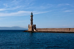 Light house harbor Hania, Crete, Greece. The lighthouse of the harbor of Hania - Chania, Crete, Greece with the Mediterranean sea and mountains royalty free stock image