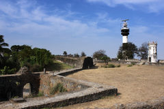 Light House on Old Fort. The Portugal era Lighthouse and the Modern Lighthouse on the Daman Fort with blue sky Stock Photography
